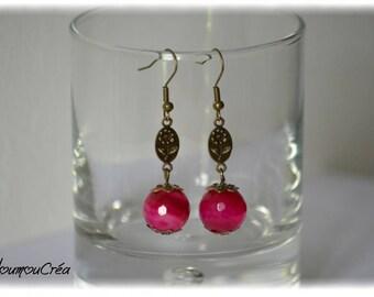 Pink stud earrings.