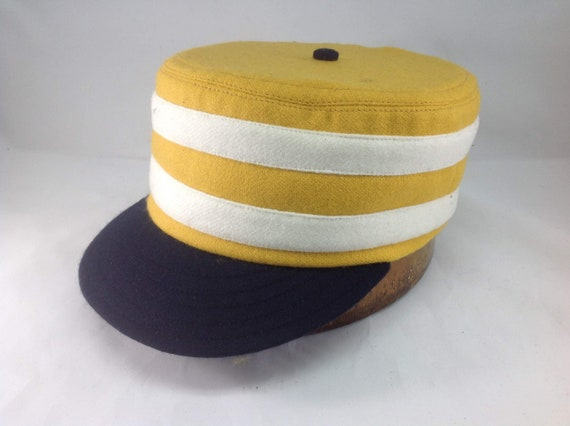 """Gold wool flannel boxcap with 2"""" navy visor, button, and 2 white wool bands. Leather or cotton sweatband, any size. Select size at checkout."""