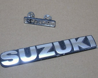 2 pieces of vintage 1982 Suzuki motorcycle badging G Series