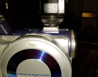 Sony Digital Handycam disc video camera with a Sony HVL-S3D video light and Sony Handycam Vision 180x digital zoom Hi8 XR camera recorder