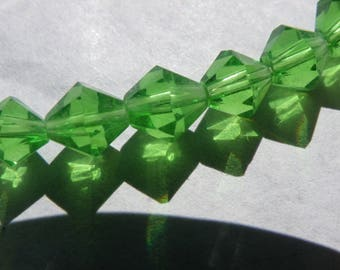 50 6 mm bizone has light green faceted transparent crystal glass beads