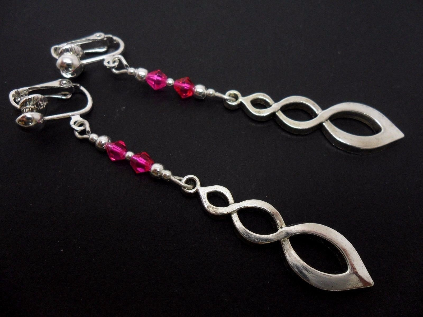 A pair of hand made tibetan silver pink crystal bead dangly twist clip on earrings.