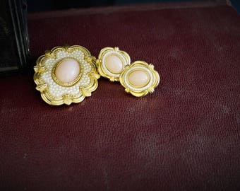 Vintage gold tone brooch with seed pearls and pink cabochon stone and matching earrings