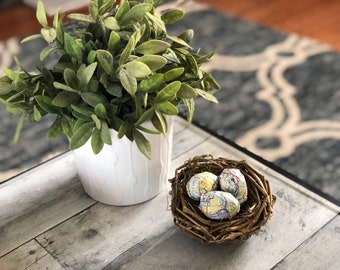 Spring decor: Nest with map page eggs