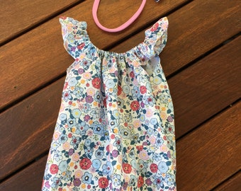 Size 0000 Floral Playsuit with flutter sleeves and matching headband.