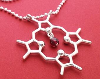 heme molecule necklace with garnet in solid sterling silver