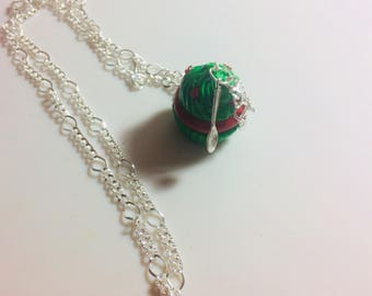 Christmas edition cupcake necklace accompanied by a spoon charm.