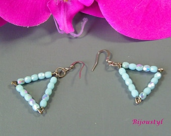 "Earrings ""Triangle"" beads reflect light blue faceted glass."