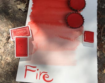 Fire. Half pan, full pan or bottle cap of handmade Fire red watercolor paint