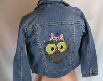 Carter's size four jean jacket/ Embroidered with an owl/Blinged with swavorski gems.