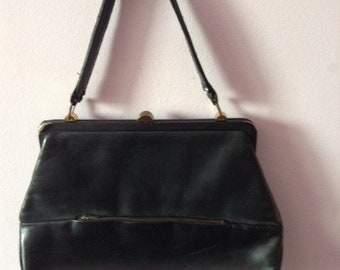 Vintage black leather hand bag with top handle and clasp 1940s 1950s madmen style