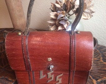 vintage small brown leather handle clutch bag with LSS brass lettering