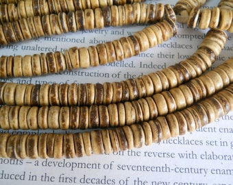 "8mm tumbled coconut heishi beads, 15.5"" strand long."