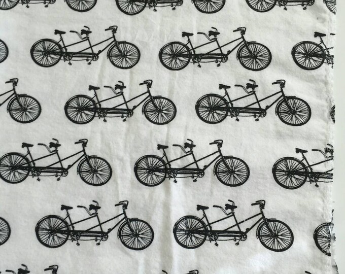 Two seated bike silhouette receiving blanket