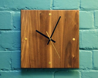 Walnut and brass clock
