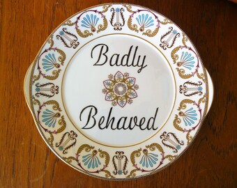 Badly Behaved hand painted vintage dinner sized cake plate with hanger recycled humor wall decor display