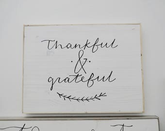 thankful and grateful black and white wooden sign