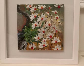 Pretty orchids in white on a canvas and framed