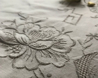Large embroidered and cutout tablecloth