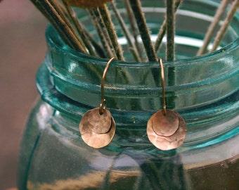 double gold disc earrings.