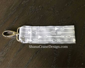 One Clip-On Lip Gloss Holder . Gray and White Arrows