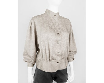 Vintage blouse in beige with peplum