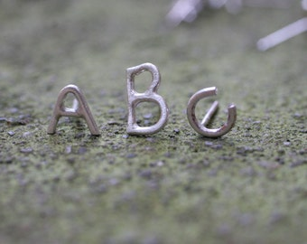 Alphabet letter stud earrings in Sterling Silver