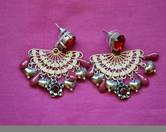 drop earrings with red charms