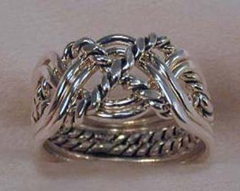 6 Pc. Sterling Silver Puzzle ring W/ A Twist
