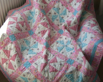 Pink and Blue Pinwheel Patchwork Quilt