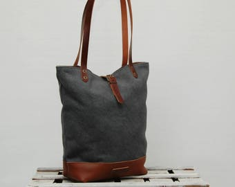 Tote bag waxed canvas, charcoal color, leather bottom in tan color,with  handles and closures in leather