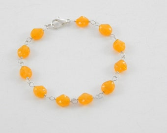 Pressed Orange Glass Bracelet.  Luminous Beads.  Sterling Silver.  Lobster Claw Clasp.  One of a Kind.  Gift.  Special.  Colorful.