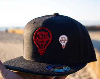 Anything is Possible Bulb Snapback