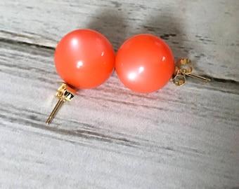 Orange moon glow post darrings gold tone metal vintage plastic moon glow earrings studs