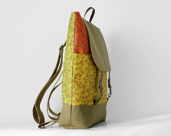 Multicolor herb backpack / laptop bag / school bag / diaper bag.  2 front pockets. 7 inside pockets. Waterproof poly lining available