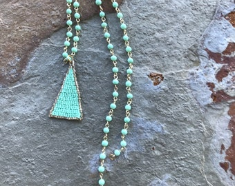 Boho style soft green beaded triangle pendant necklace on a wired beaded chain