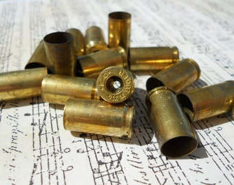 15 brass shell casings 9mm primer removed