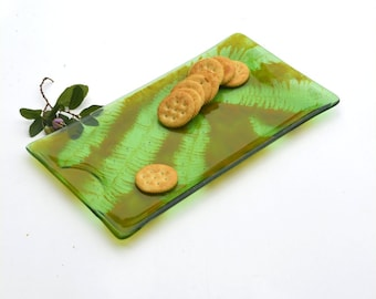 Fused glass plate, transparent green with ferns in a butterscotch brown