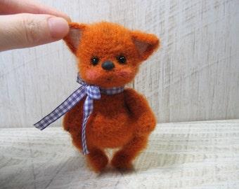 Miniature hand knitted Fox