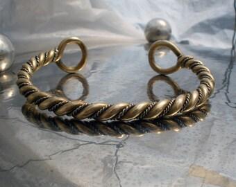 Viking infinite twisted  hand torc bracelet.