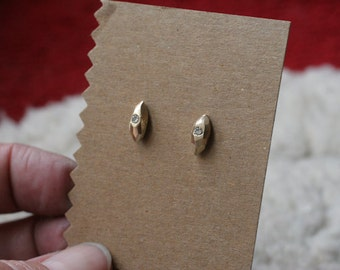 Faceted stud earrings with diamonds in solid 14k yellow gold
