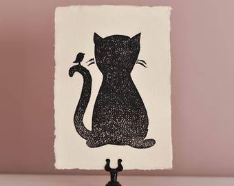 Kat met vogel op handgemaakt papier