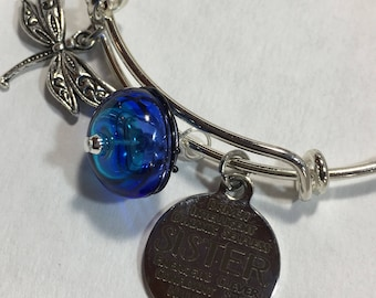 Bracelet, adjustable silver plated bangle Sisters word print with hollow lampwork bead and dragonfly charm