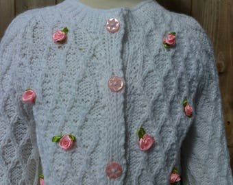 Hand knitted white cardigan with pretty pink roses