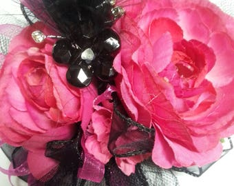 Wrist corsage and matching boutonnière set made with realistic-looking hot pink / fuchsia roses.