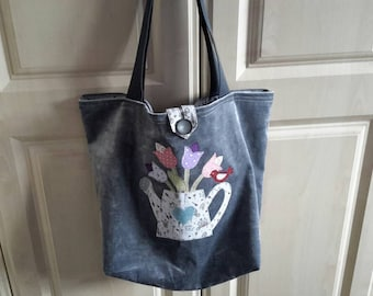 Grey velvet Tote Bag with garden watering can filled with flowers