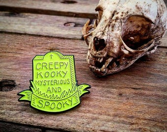 Spooky Glow Pin Badge 30mm Addams Family Inspired Creepy Kooky Mysterious & Spooky Horror Geek Grave Tombstone Scary Gothic
