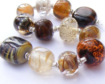 Lampwork orphans - glass bead set of 12 mainly brown renegade beads