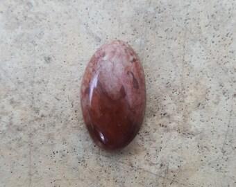 Wonderstone oval cabochon 27 x 16 x 5