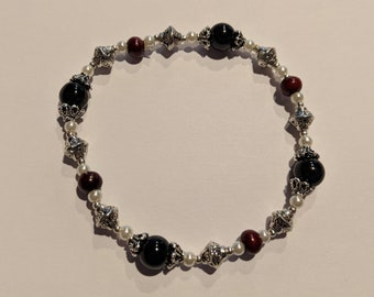 Beautiful silver, black and red tibetan style beaded stretchy bracelet